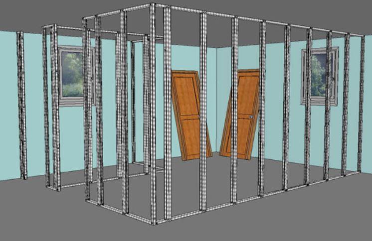 Ossature métallique en rails et montants prête à accueillir les plaques de plâtre.